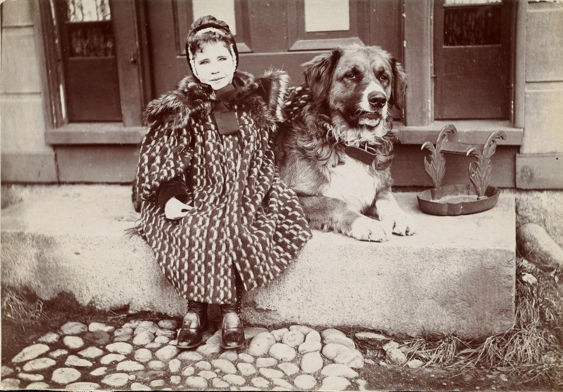 Higgins Girl seated with dog