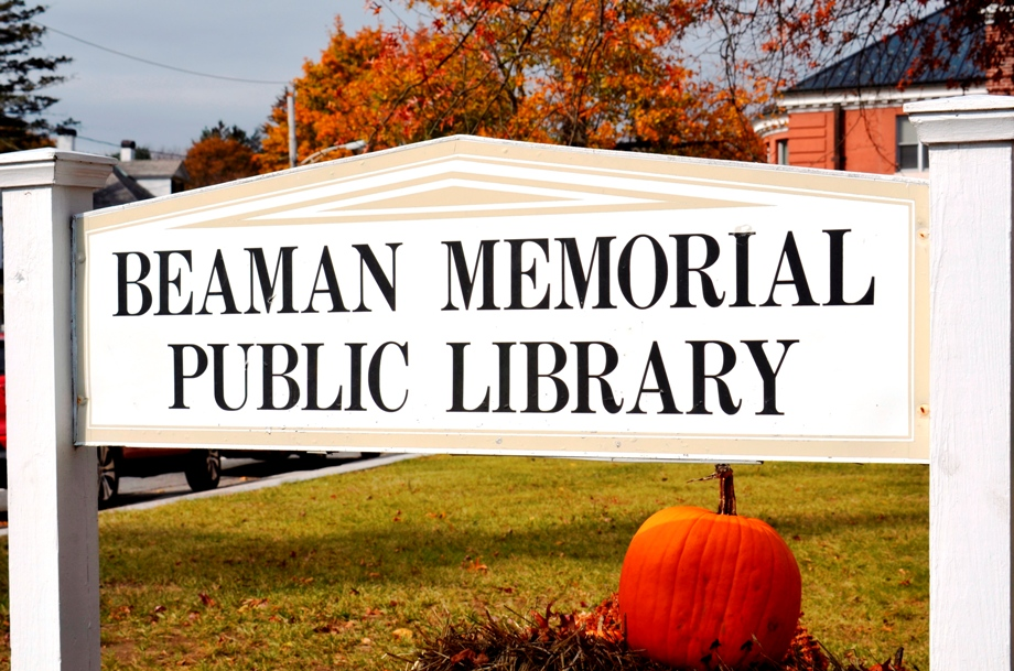 Photograph of the Beaman Memorial Public Library sign in front of the Library