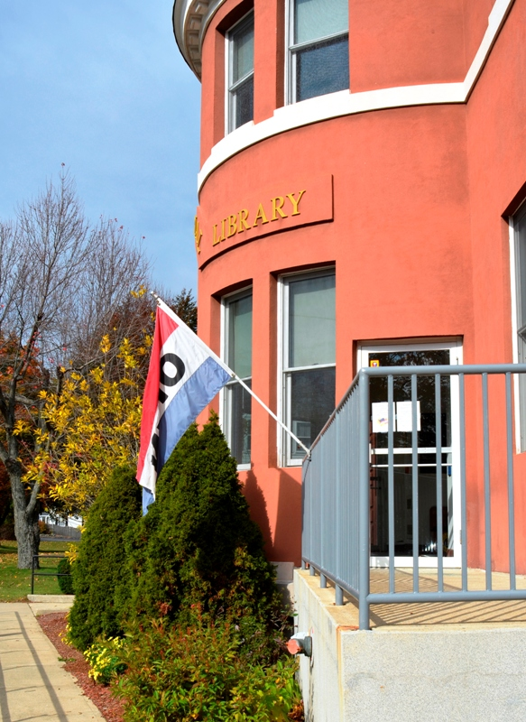 Photograph of the open flag at the side entrance to the Library